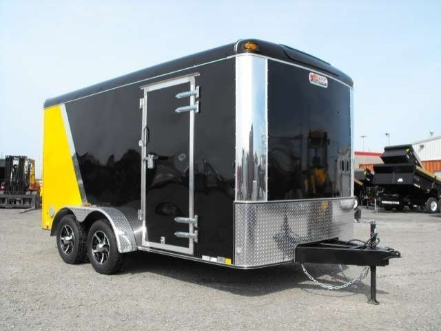 black and yellow tandem axle enclosed cargo trailer