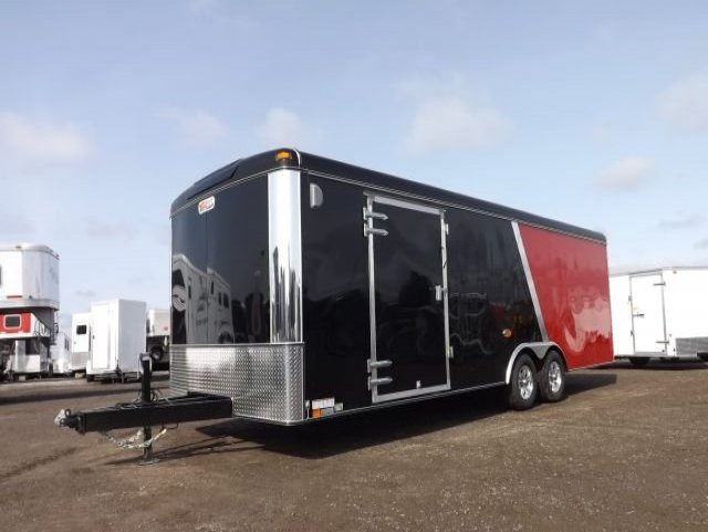 red and black tandem axle enclosed cargo trailer